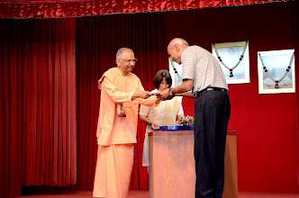 Photo: Mr Uthaychanran receiving the award on behalf of his son who did well in A level.