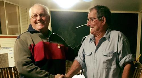 Bill Guest receives his life membership off Ian 'Bones' Falkiner.