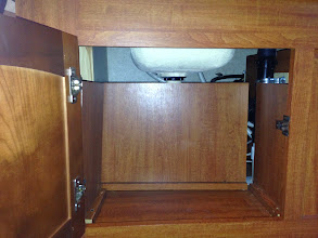 Photo: Undersink Mod: There was a panel blocking off half the space under the sink, due to the p-trap and wiring.