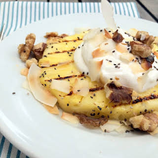 Grilled Pineapple with Cream, Coconut, and Walnuts.