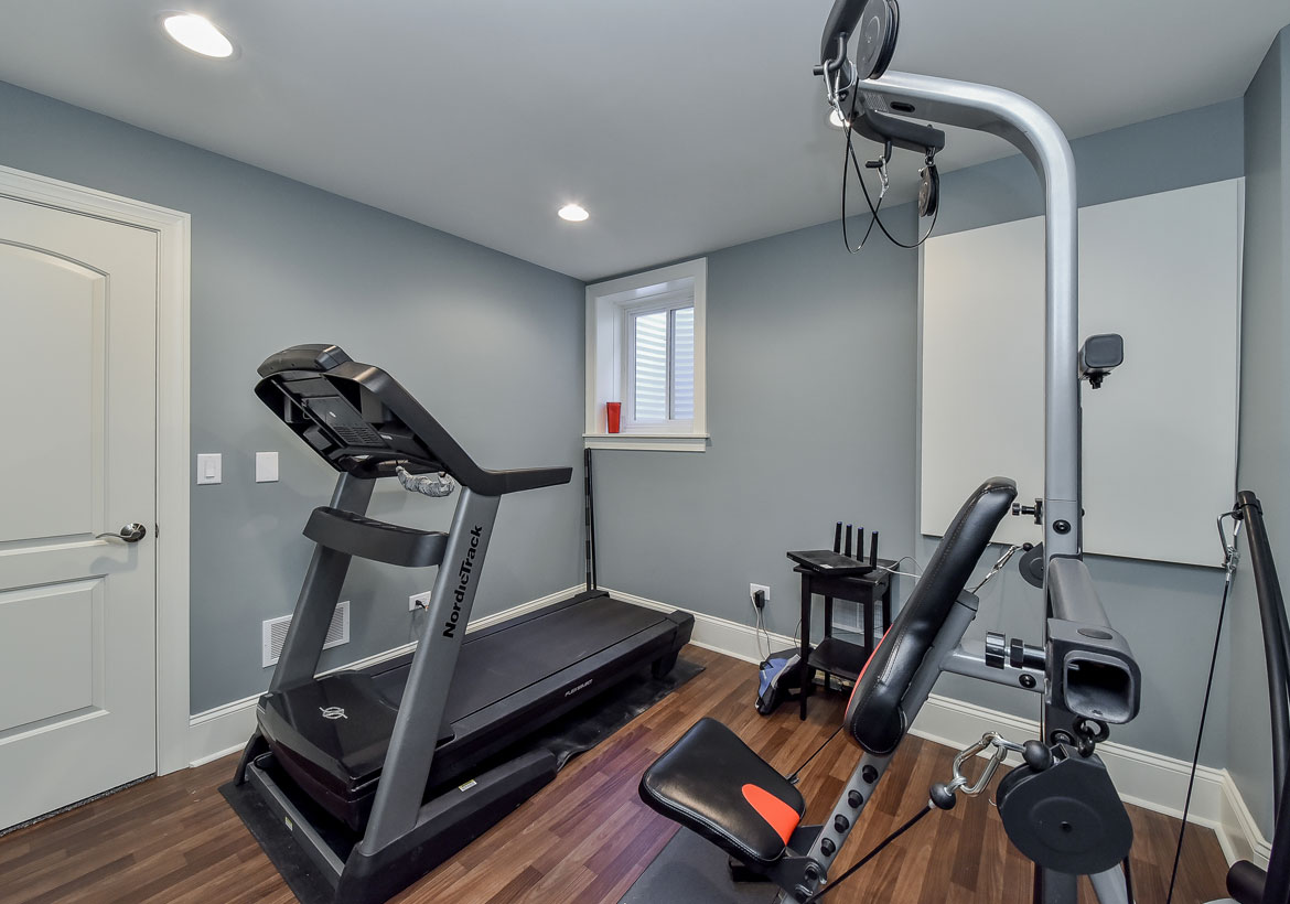 Small home gym in a spare room