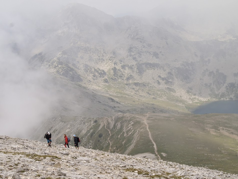 Hikers making their way up Mt. Vihren among the clouds