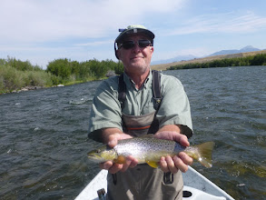 Photo: Dan Monfort and a Madison River Brown trout with Mad River Outfitters