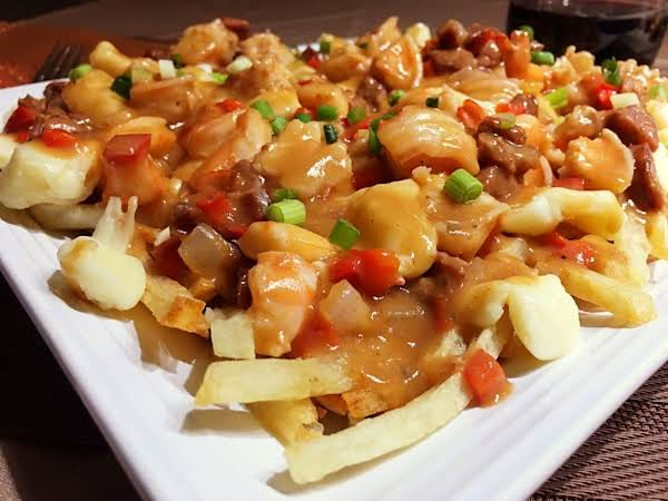 French Fries, Shrimp, Gravy And Topped With Green Onions.