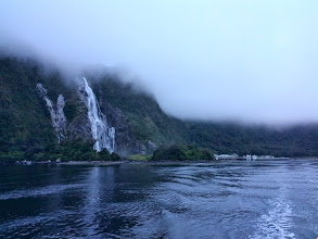 Photo: More cloudy Milford Sound.  Apparently when it rains, waterfalls like this appear all along the fjord.  Another interesting fact, this one true, Milford Sound is a misnomer -- it's a fjord.  The next photo shows how much mountain is hidden above the cloud.  A lot.