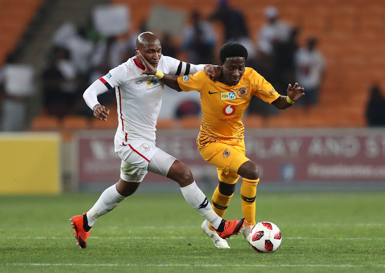 Kaizer Chiefs attacking midfielder Siphelele Ntshangase pulls away from Free State Stars captain and midfielder Paulus Masehe during the MTN8 3-0 quarterfinal win for Amakhosi at FNB Stadium on August 11 2018.