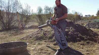 Photo: Matt Banchero demonstrates the Stihl leaf vacuum with metal impeller operated as a char collection and size reduction tool.
