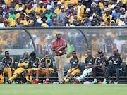 Kaizer Chiefs head coach Steve Komphela asks the match referee for time left during the Absa Premiership match against Orlando Pirates at FNB Stadium on Saturday March 3 2018.