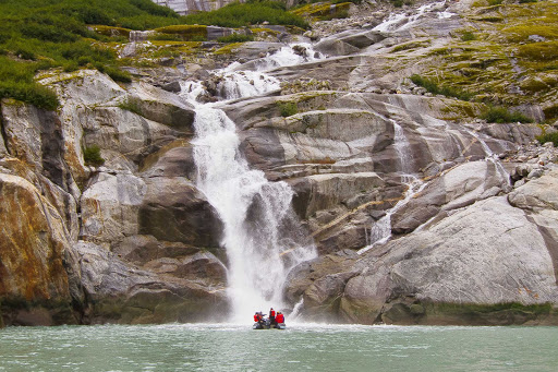 Uncruise-skiff-waterfall.jpg - The small ships of UnCruise Adventures take you closer to waterfalls and spots too remote for larger ships.