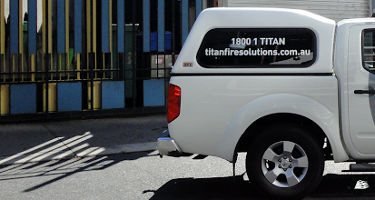 Photo: Vehicle decals, cut from stock 3M vinyl, no print elements. Artwork supplied.