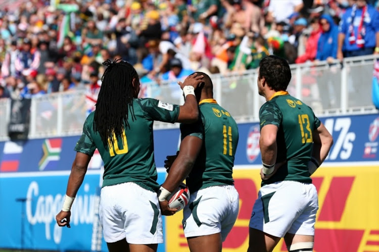 Cecil Afrika, Siviwe Soyizwapi, and Ruhan Nel of South Africa celebrate after scoring a try against Argentina during day 2 of the 2018 HSBC USA Sevens at Sam Boyd Stadium on March 03, 2018 in Las Vegas, United States of America.