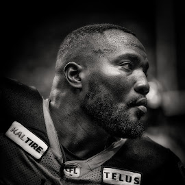 Defensive Tackle Warrior - B&W by Garry Dosa - Black & White Portraits & People ( black & white, b&w, sports, players, black, indoors, cfl, football, portrait, people )
