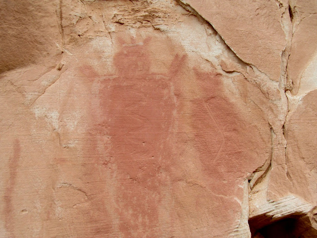 Abrasions over pictographs over petroglyphs
