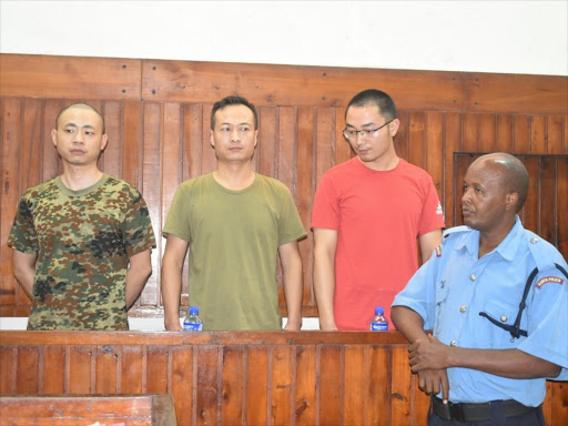 Three Chinese in SGR ticket sale scam deny bribery charge
