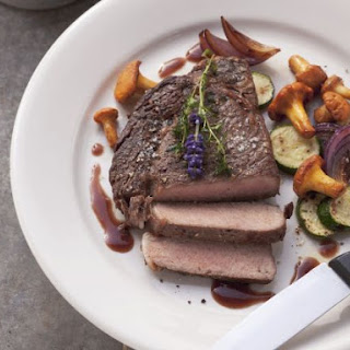 Steak with Gourmet Mushrooms and Jus.