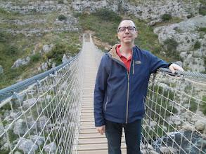 Photo: Chris on the bridge heading back to town