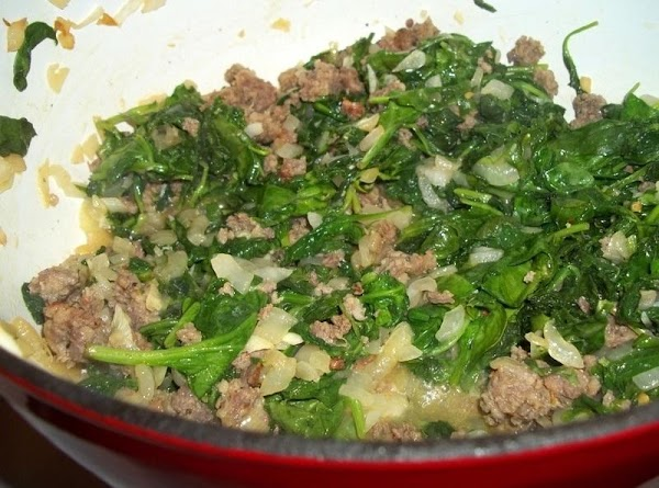 Next, add the kale, spinach and garlic. Continue cooking a few more minutes until...