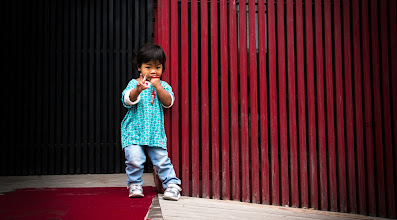 Photo: Here's a young girl (I guess? Hehe) I found back in a hutong not too far from where I stayed. If you ever get tired of the major sites around Chinese cities, a few steps back into the neighborhoods have an infinite number of scenes to shoot.