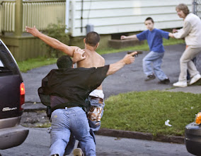 Photo: WILLIAM P. CANNON / Observer-Dispatch New York State Parole Officer Anthony Stucchi, left, chases and tackles Joseph Elias, 22, Utica, Wednesday, Sept. 10, 2008, on Wager Street, in Utica, as residents Tyler Wallace, 8, Noah Napp, 6, and Kathy Docko get out of the way. The suspect fled from police by car, hit a bicycle with a child on it, and then fled on foot, police said. The child was not injured. The man was arrested.