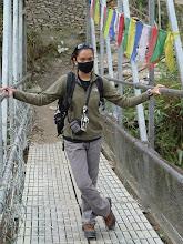Photo: Emily crossing a bridge at Birethanti