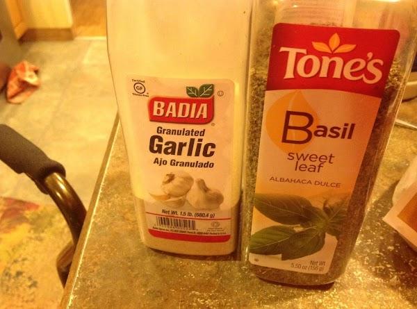 Season with garlic powder & sweet basil & stir to blend together..
