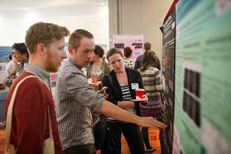 "Photo: Wouter Masselink explaining his poster, ""Evolutionary emergence of limbs: a unifying hypothesis as evidenced by infiltration of somitic mesoderm into the Apical Ectodermal Ridge"""