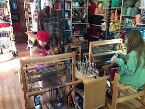 Photo: home school class into into saori weaving.