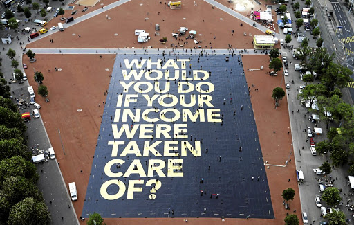 Loud voice: A poster on the Plainpalais square in Geneva, Switzerland, in May 2016 — a month before the country held a referendum on an unconditional basic income. The Swiss who voted soundly rejected the proposal but the debate is far from over in the Alpine country. Picture: REUTERS