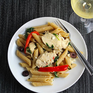 Mediterranean Chicken Pasta with Spinach and Red Bell Peppers.