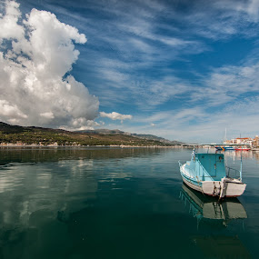 by Grigoris Koulouriotis - Transportation Boats ( clouds, sky, blue, greece, sea, boat,  )