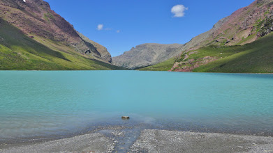 """Photo: This is at the head of the lake where melt-water from Siyeh Glacier enters the lake. The opaque blue water of lakes like this is called """"glacial milk""""."""