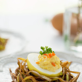 Turmeric Colored Deviled Eggs in a Leek Nest.