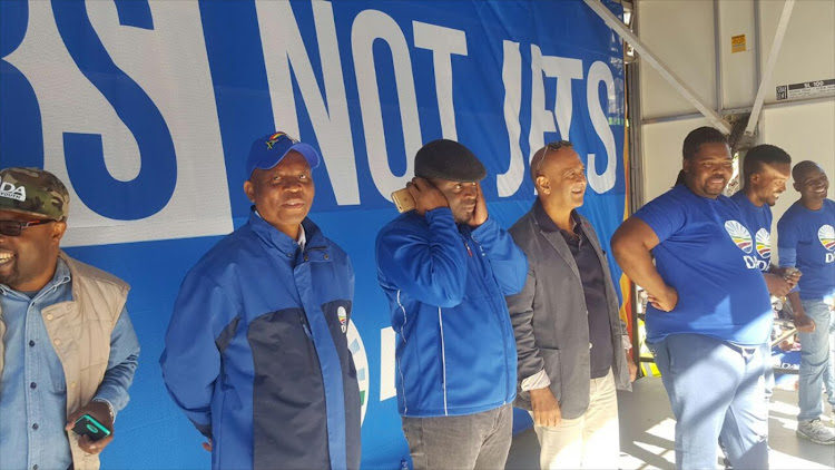 Now-Joburg mayor Herman Mashaba (2nd from left) and now-Tshwane mayor Solly Msimanga (middle) at a Democratic Alliance rally in June 2016.