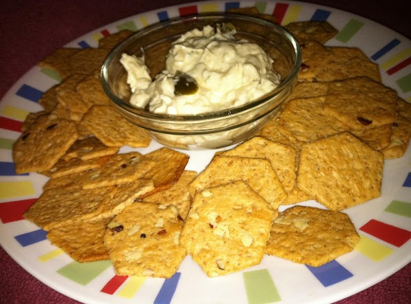 Place bowl of dip in center of a plate or platter.  Put crackers...