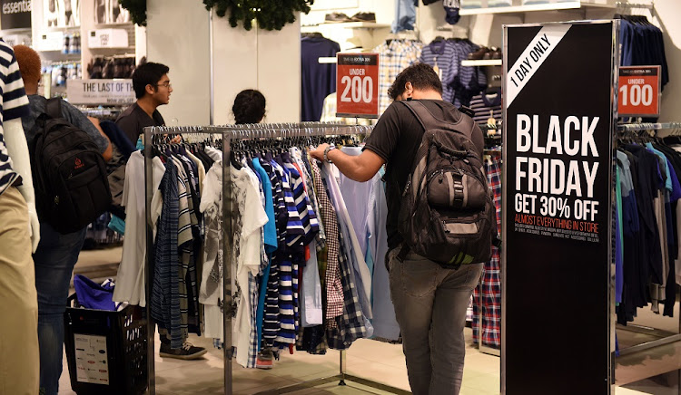 Shoppers hunt for Black Friday bargains at Rosebank Mall in Johannesburg in this November 25 2016 file photo. Picture: FINANCIAL MAIL/FREDDY MAVUNDA
