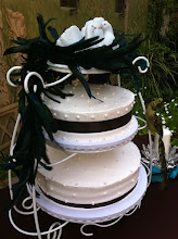 Photo: Split stand wedding cake featuring smooth whipped cream icing studded with edible pearls & black satin ribbon wrap.
