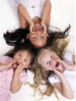 Three girls smiling and yelling