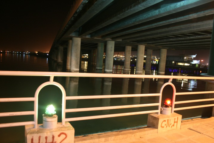 """Photo: People go to a bridge in Karachi called """"Native Jetty"""" to jump to their deaths. Others frequent the same spot to toss dough balls into the water for luck. This juxtaposition of hope and despair is just one of the contrasts in Karachi -- and in Pakistan as a whole. http://to.pbs.org/JhqggW"""