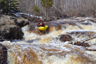 "Photo: Kayaker Tony Locken of Chaska, Minn., makes his way down the rapid Naked Man just before the start of the Lester River Race. Locken was in the second heat so he would be a ""safety boat"" in the first heat, standing at the bottom of the run to help boaters who got into trouble."