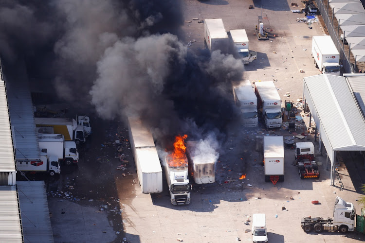 A general view of burning trucks during unrest in Durban, KwaZulu-Natal. Picture: REUTERS/Rogan Ward