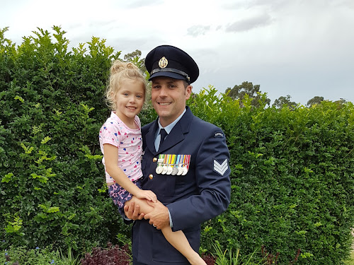 Conspicuous Service Medal awardee Ben Hutchen with his elder daughter Olivia.