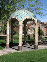 Photo: A ceramic gazebo; behind it a stained glass sculpture.