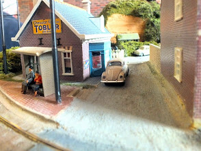 Photo: 007 A nice ground level view along one of the streets at Simon Hargreaves HOm pizza layout, whilst an elderly couple wait for the tram to arrive .