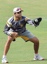 Photo: Pakistan cricketer Azhar Ali catches a ball during a practice session at the R. Premadasa Stadium in Colombo on June 15, 2012.  The remaining two matches in the one-day series between Sri Lanka and Pakistan will have reserve days due to rains in the country, Sri Lanka Cricket (SLC) announced. The last two day-night games of the five-match series are scheduled to be played in Colombo on June 16 and 18 with rain forecast for both days.   AFP PHOTO/ LAKRUWAN WANNIARACHCHI        (Photo credit should read LAKRUWAN WANNIARACHCHI/AFP/GettyImages)