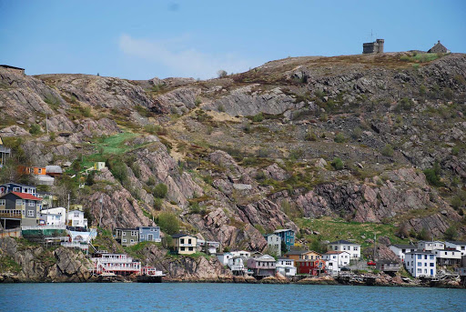 avalon-newfoundland-coastal-town.jpg - A hillside view of a small coastal town on the Avalon Peninsula in Newfoundland.