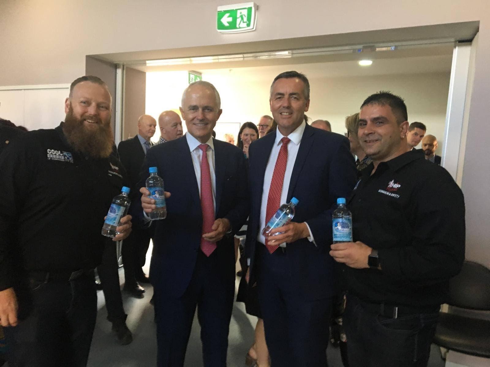Alfi Prestipino, Gareth Williams and Malcom Turnball each enjoying a bottle of refreshing Cool Aqua Springs wate