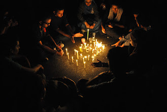Photo: Sharing candle light in Talat Harb Square.