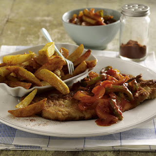 Schnitzel with French Fries and Bell Pepper Sauce.