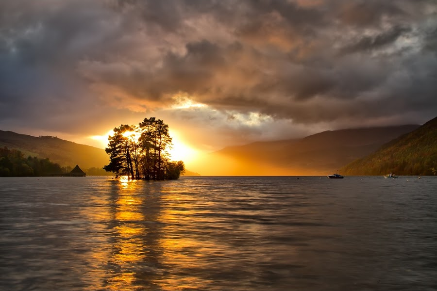 Devils night approaching  by Neil O'Connell - Landscapes Sunsets & Sunrises ( water, kenmore, scotland, sunset, boats, storm clouds, loch, sunbeam )