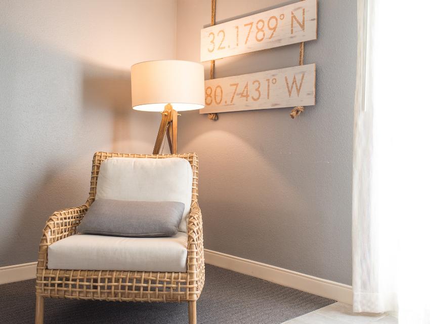 warm lighting wicker chair cushion light gray tan room cozy winter
